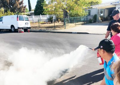 Three Home Village staff fire extinguisher training.