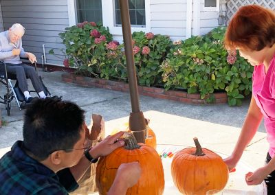 Three Home Village staff carving pumpkins